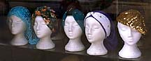 [ Head coverings in Machne Yehuda (Jewish market) shop window ]